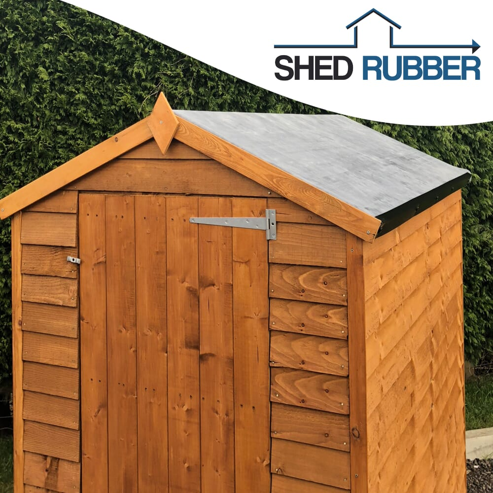 brown shed with a rubber roof
